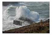 Storm waves hitting harbour wall
