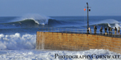 big wave and harbour wall porthleven